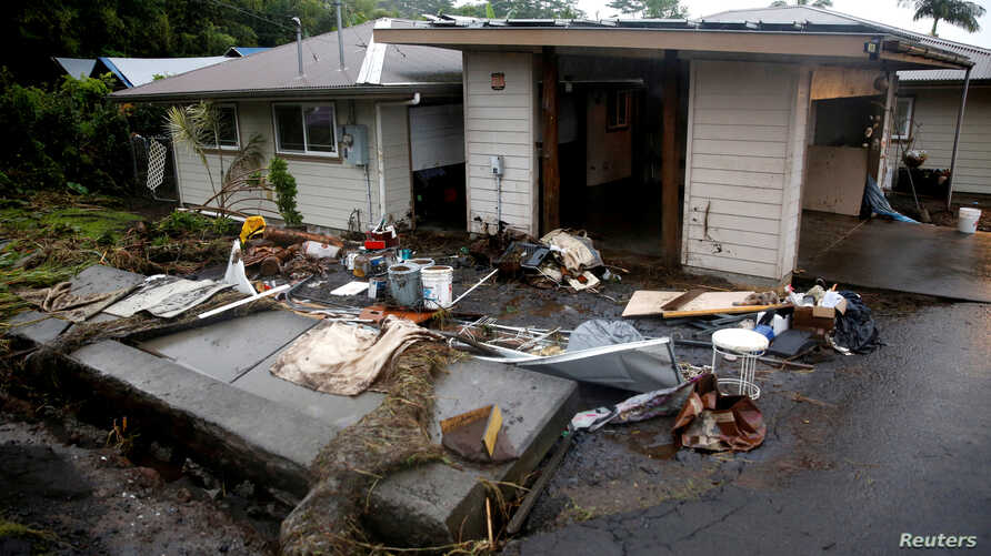 FILE PHOTO: A retaining wall lies on its side after being toppled by flooding caused by Hurricane Lane in Hilo, Hawaii, U.S., August 25, 2018.