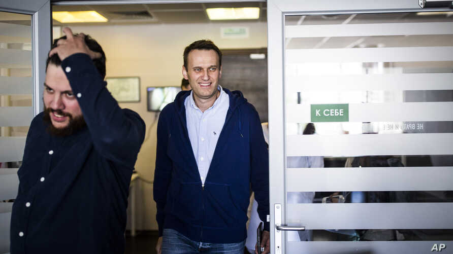 Russian opposition leader Alexei Navalny smiles as he arrives at his office in Moscow, Russia, July 7, 2017.