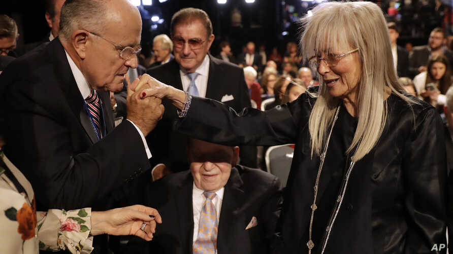 Former mayor of New York City Rudy Giuliani, kisses Miriam Adelson's hand at Hofstra University in Hempstead, N.Y. Miriam Adelson is a doctor, philanthropist and humanitarian, but is perhaps best known as the wife of Sheldon Adelson, a Las Vegas casi