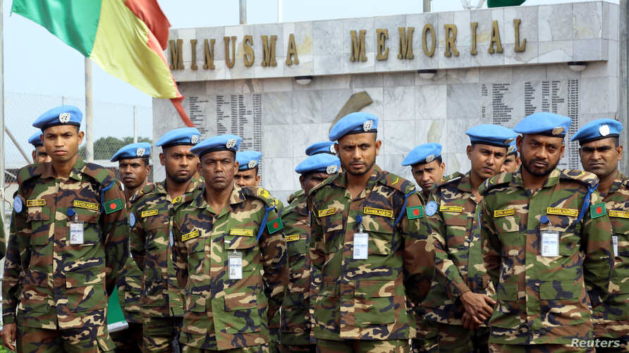 FILE - U.N. peacekeepers attend a memorial ceremony for their comrades at the MINUSMA base in Bamako, Mali, Sept. 27, 2017. Four peacekeepers were killed Wednesday in Mali when their vehicle ran over a mine.
