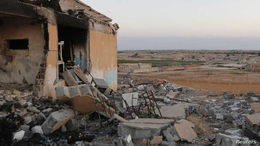 A general view shows a damaged school that was targeted on Monday by what activists said were U.S.-led air strikes, at Ain al-Arous town in Raqqa governorate, October 1, 2014.