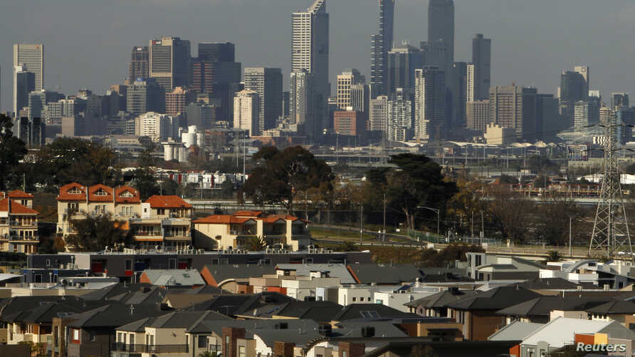FILE - A housing development area is seen with the Melbourne, Australia, skyline in the distance, June 2, 2010.