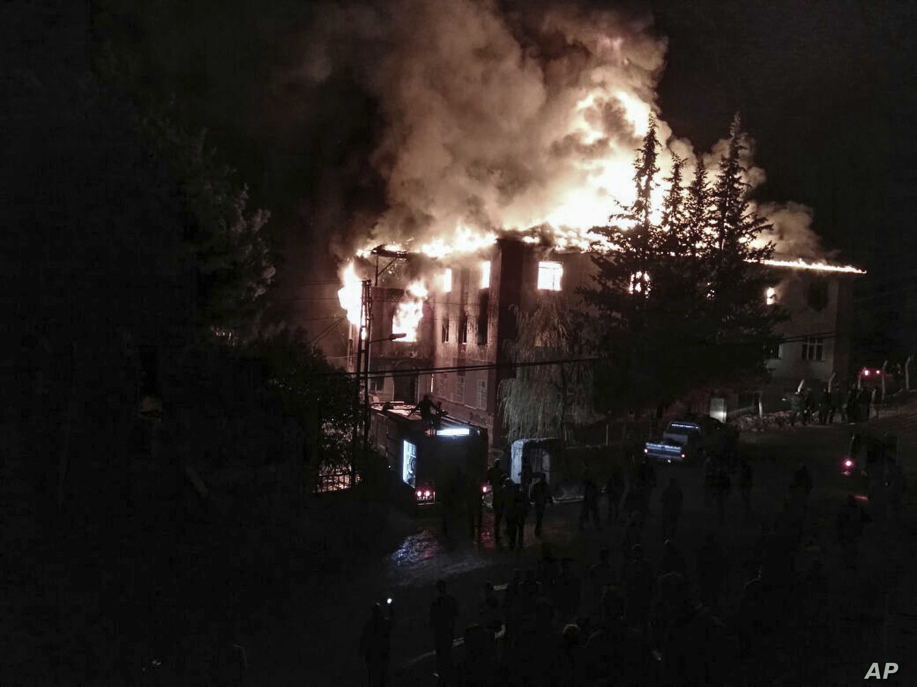 Flames rise from a fire in a school dormitory, in Aladag, Adana, in southern Turkey, Nov. 29, 2016.