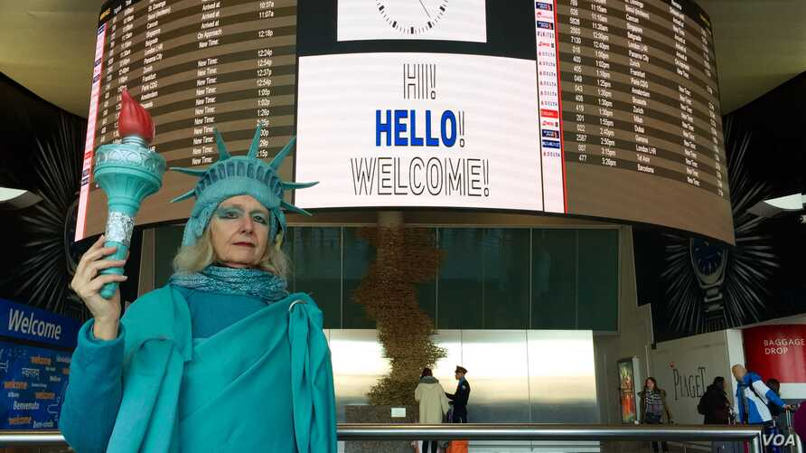 """Lindley Hanlon, a film professor at CUNY, spent Monday afternoon at JFK international airport to welcome refugees. """"I'm trying to welcome people to our shores, as I've always done for 131 years,"""" she said, referring to Lady Liberty's arrival in New Y"""