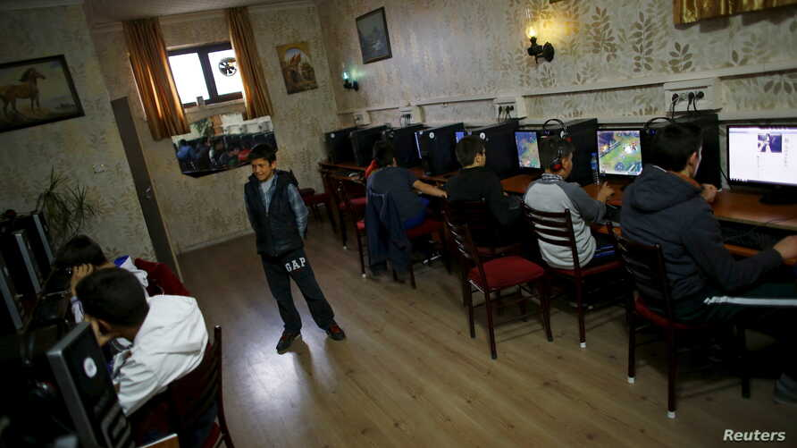 FILE - People use computers at an internet cafe in Ankara, April 6, 2015.