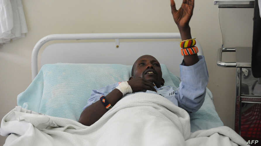 An injured Kenyan policeman lies on a hospital bed in Nairobi on November 11, 2012 recounting how he an others were attacked in Baragoi, Samburu North District yesterday.