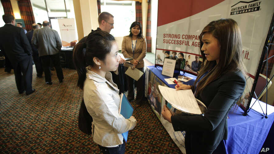 Eastern Washington University student Lihn Phung, talks to Lieu Vo, an agency sales manager assistant with American Family Insurance, about internship opportunities during a National Career Fairs job fair.
