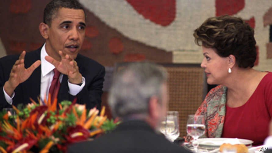U.S. President Barack Obama, left, speaks during lunch with Brazil's President Dilma Rousseff at Itamaraty Palace in Brasilia, Brazil, Saturday March 19, 2011.
