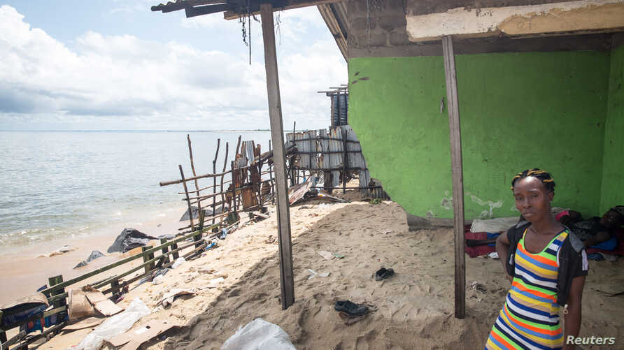 Gbeneweieh Quoh surveys what remains of her home at the edge of West Point township, Monrovia, Liberia, June 7, 2018.