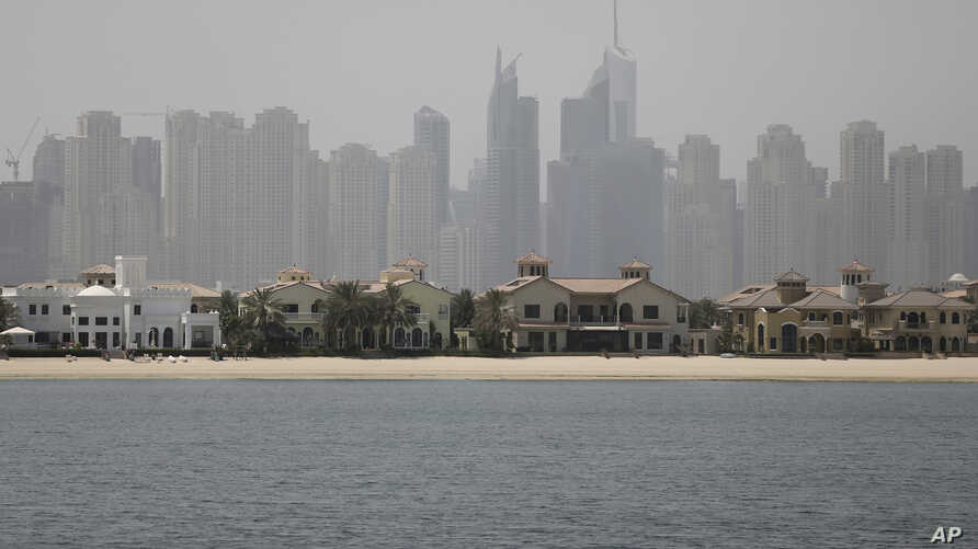 Jumeirah Palm Island luxury villas are seen by their private beaches in Dubai, United Arab Emirates, June 6, 2018. A new report released Tuesday, by the Washington-based Center for Advanced Defense Studies, relying on leaked property data from the ci