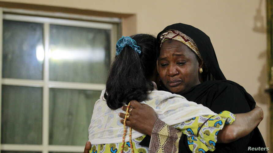 Mourners embrace each other as they pay their respects during a visit to the family of Bilikisu Yusuf, in Kaduna, Nigeria, one of the victims of the stampede which occurred in Saudi Arabia's Mina, Sept. 26, 2015.