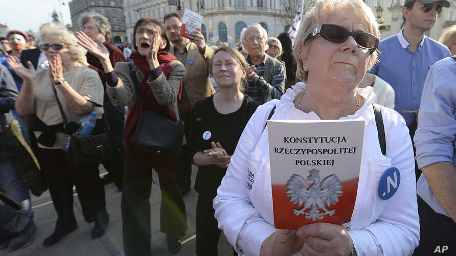People demonstrate on the 20th anniversary of Poland's constitution in front of the presidential palace in Warsaw, Poland, on Sunday, April 2, 2017.