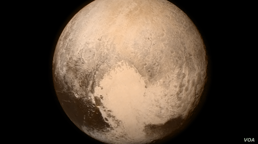 NASA image of Pluto showing heart shaped Tombaugh Regio. Credit: NASA/Johns Hopkins University