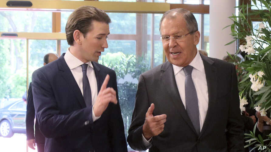 Austrian Foreign Minister Sebastian Kurz talks with Russian Foreign Minister Sergey Lavrov, right, before a informal ministerial meeting of the Organization for Security and Cooperation in Europe, OSCE, in Mauerbach near Vienna, Austria, July 11, 201