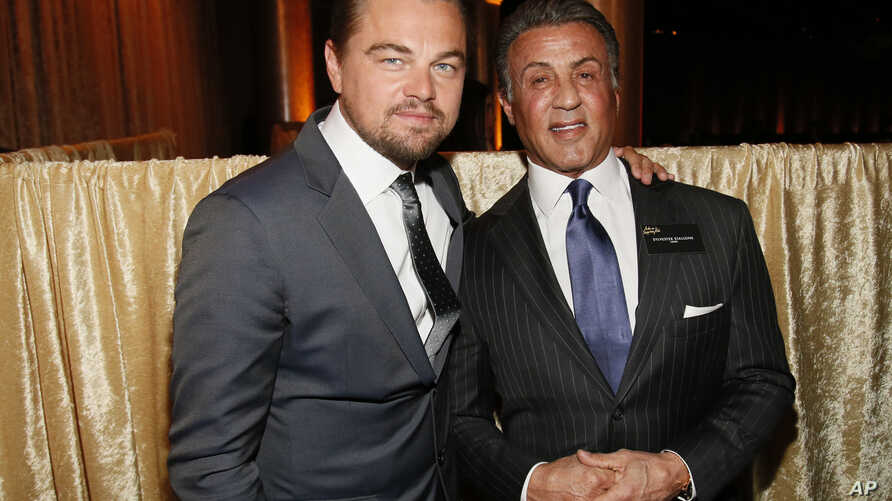 Leonardo DiCaprio, left, and Sylvester Stallone attend the 88th Academy Awards Nominees Luncheon at The Beverly Hilton hotel, Beverly Hills, California, Feb. 8, 2016.