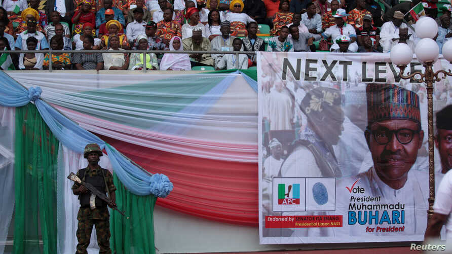 FILE - A soldier stands guard during a launch campaign by the ruling All Progressives Congress (APC) party for President Muhammadu Buhari's re-election bid, in Uyo, Nigeria, Dec. 28, 2018.