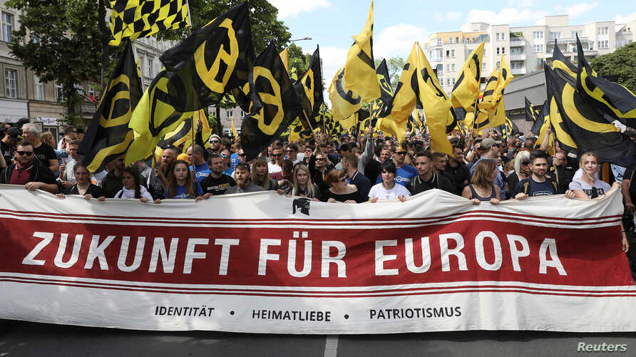 """FILE - Protestors carry a banner that reads: """"Future for Europe"""" during a demonstration of the far-right Identitarian Movement (Identitaere Bewegung) in Berlin, June 17, 2017."""