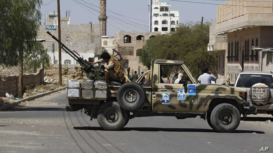 A Houthi Shiite rebel mans a machine gun mounted on a military truck in Sanaa, Yemen, Monday, Oct. 20, 2014.