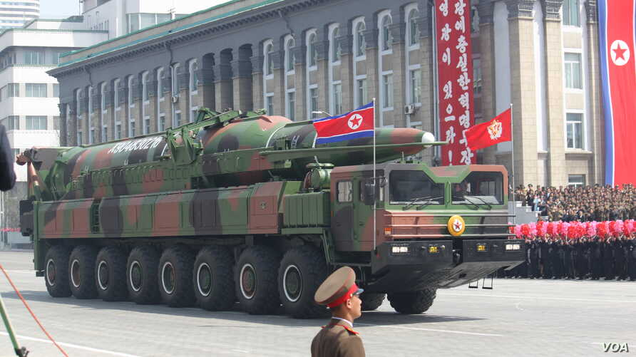 A North Korean military vehicle carries what is believed to be a Taepodong-class ballistic missile during a military parade in Pyongyang, April 15, 2012.