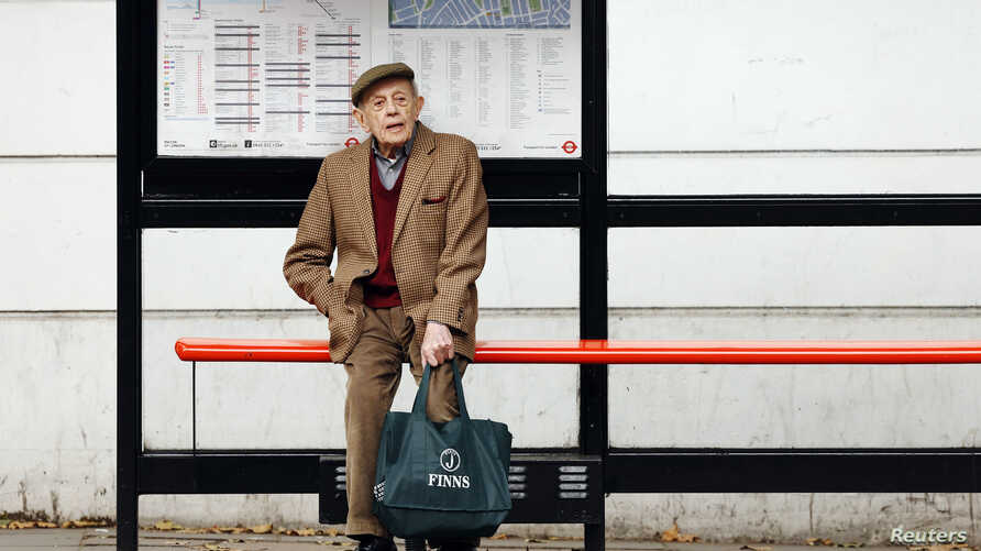 "FILE - A man sits by himself at a bus stop in London, Oct. 18, 2013. Health Secretary Jeremy Hunt said at the time that there were hundreds of thousands of people in England who were chronically lonely. A ""minister of loneliness has now been appointe"