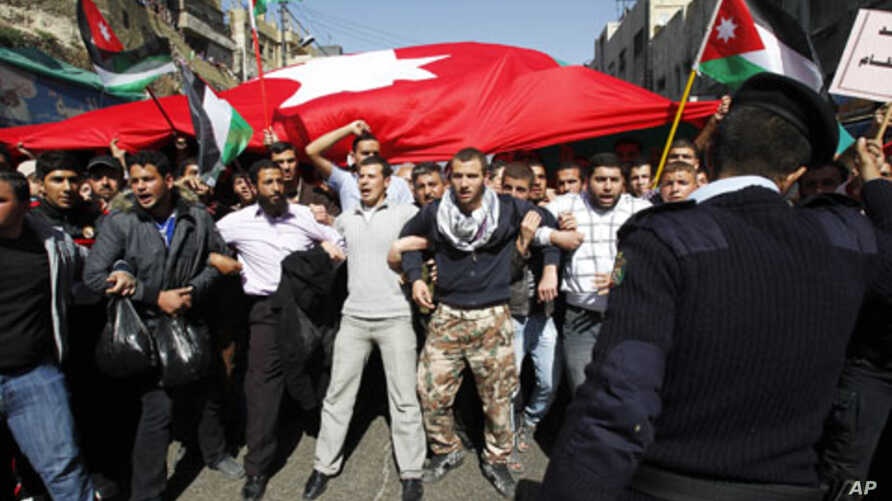 Anti-government protesters shout slogans during a demonstration after Friday prayers in Amman, Jordan, March 04, 2011