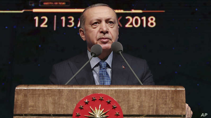 "Turkey's President Recep Tayyip Erdogan delivers a speech during a defense industry meeting event in Ankara, Turkey, Dec. 12, 2018. Erdogan said Turkey will begin ""within a few days"" a new military operation to drive out U.S.-backed Syrian Kurdish fi..."
