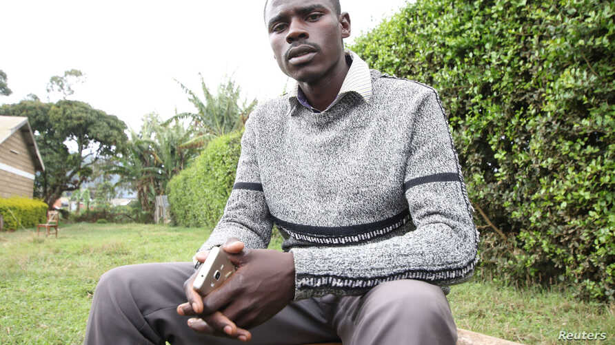 Independent John Paul Mwirigi, who is now a member of the Kenyan parliament, sits outside the tallying center in Maua Girls High School, in Maua, Kenya, Aug. 9, 2017. Mwirigi won the election wearing just one sweater, having no car and not handing ou