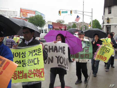 Korean immigrant workers, represented by AALDEF, held a protest with supporters against abusive employment practices at a New Jersey restaurant in April, 2010.""