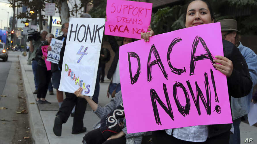 Demonstrators urging the Democratic Party to protect the Deferred Action for Childhood Arrivals Act (DACA) rally outside the office of California Democratic Sen. Dianne Feinstein in Los Angeles, Jan. 3, 2018.