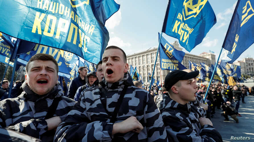 Activists and supporters of the National Corps political party attend a rally to demand an investigation into the corruption of Ukraine's armed forces officials, in Kyiv, Ukraine, March 9, 2019.