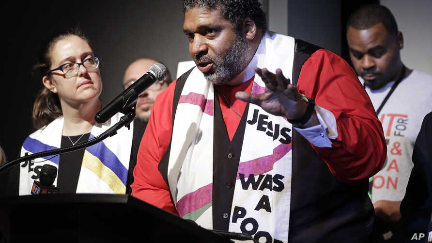 The Rev. Dr. William J. Barber II, center, and Rev. Dr. Liz Theoharis, left, co-chairs of the Poor People's Campaign, speak at the National Civil Rights Museum in Memphis, Tennessee, April 3, 2018.