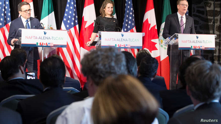 Ildefonso Guajardo, Mexico's Secretary of Economy; Chrystia Freeland, Canada's Minister of Foreign Affairs; and Robert Lighthizer, United States Trade Representative, make statements to the media, in Montreal, Quebec, Canada, Jan. 29, 2018.