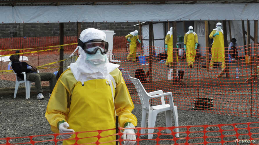 Medicins Sans Frontieres (MSF) health workers prepare at ELWA's isolation camp during the visit of Senior United Nations (U.N.) System Coordinator for Ebola David Nabarro, at the camp in Monrovia Aug. 23, 2014.