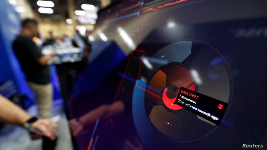"""FILE - A data theft alert is displayed on a """"threat spiral"""" at the ProtectWise booth during the Black Hat information security conference in Las Vegas, July 26, 2017."""