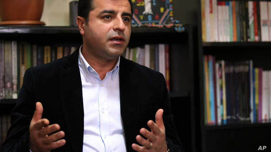 Selahattin Demirtas of the pro-Kurdish People's Democratic Party (HDP) speaks at a news conference at Ozgur radio station in Istanbul, Turkey, Oct. 30, 2015.
