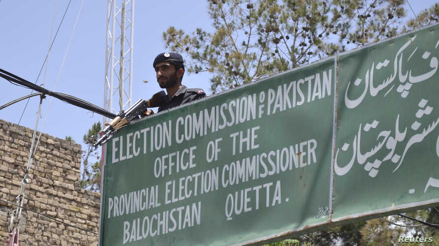 FILE - A policeman stands guard at an election commission office in Quetta, May 8, 2013. Pakistan's Election Commission has again rejected the registration of Milli Muslim League, citing its alleged terror ties. General elections are scheduled for Ju