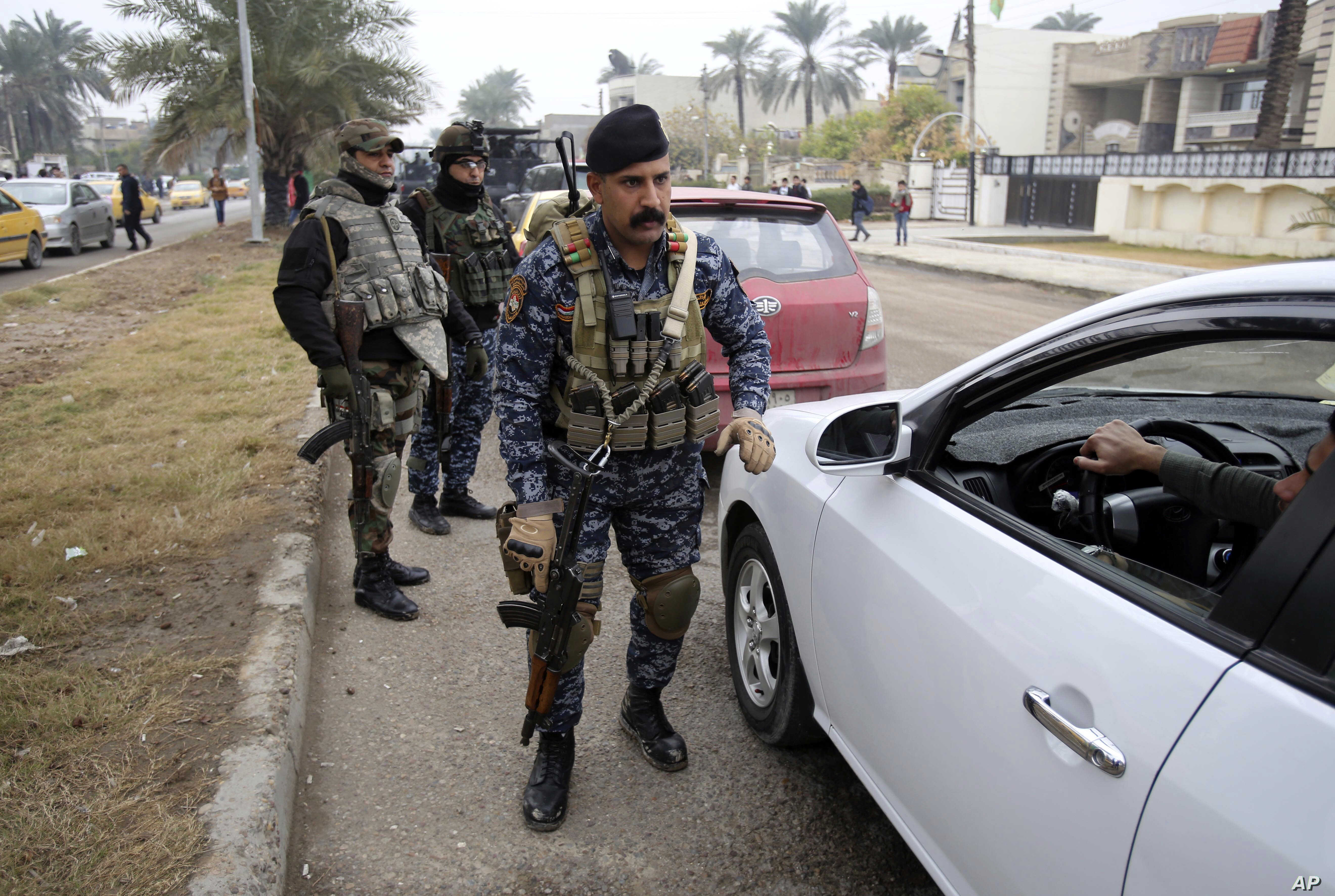 Iraqi security forces deploy in Baghdad's southwestern Saydiyah neighborhood searching for  kidnapped journalist Afrah Shawqi al-Qaisi, in Baghdad, Iraq, Dec. 27, 2016.