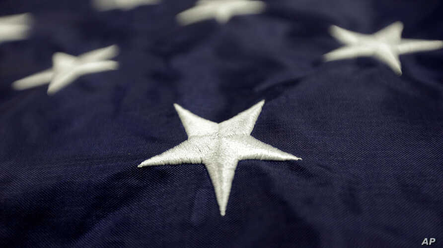 FILE -  stars sewn into a United States flag made at Annin Flagmakers in South Boston, Va.