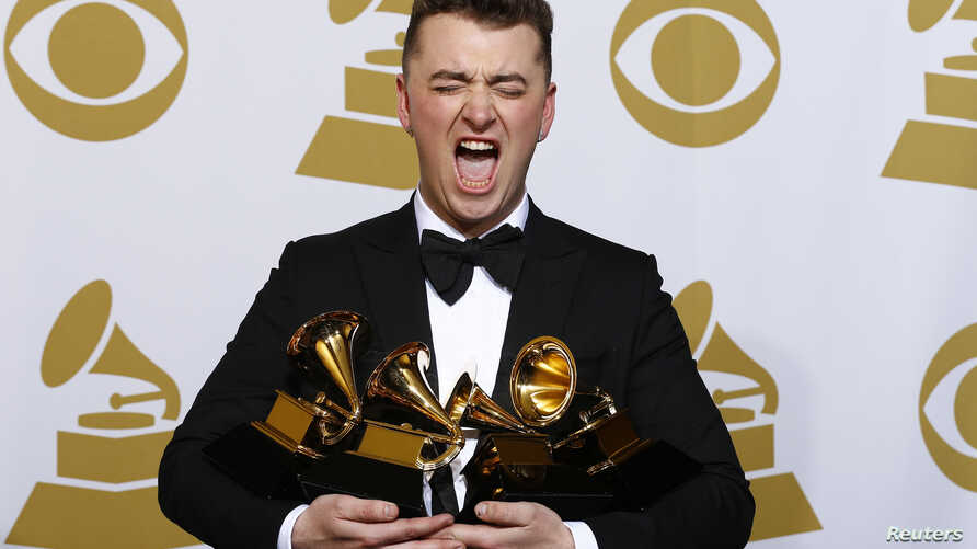 """Sam Smith poses with his awards for Best New Artist, Best Pop/Vocal Album for """"In the Lonely Hour"""" and Song of the Year and Record of the Year for """"Stay With Me"""" in the press room at the 57th annual Grammy Awards in Los Angeles, California, Feb. 8, 2..."""
