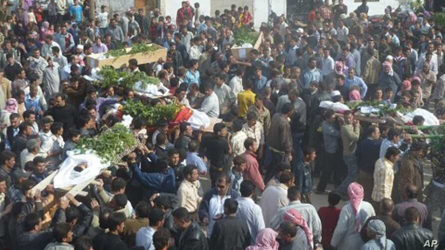 Anti-government protesters carry the coffins of Sunni Muslim villagers killed on Wednesday, in Hula near Homs, November 2, 2011.