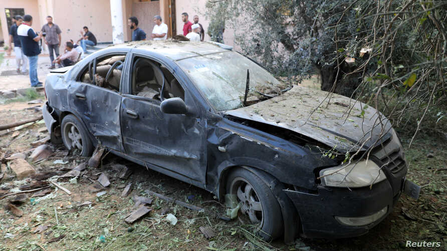 A damaged car is seen during clashes between rival factions in Tripoli, Libya, Aug. 30, 2018.