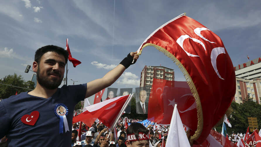Gray wolves, the supporters of Turkey's opposition Nationalist Action Party, MHP, wave their flags during a rally ahead of the June 7 general elections, in Ankara, Turkey,  Sunday, May 24, 2015.