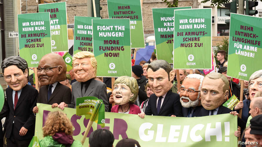 Oxfam's Big Heads depict G20 leaders take part in protests ahead of the upcoming G20 summit in Hamburg, Germany, July 2, 2017.
