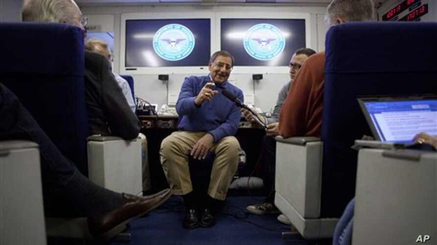 Defense Secretary Leon Panetta briefs the media on board a plane en route to a NATO conference in Brussels, Belgium, Feb. 1, 2012.