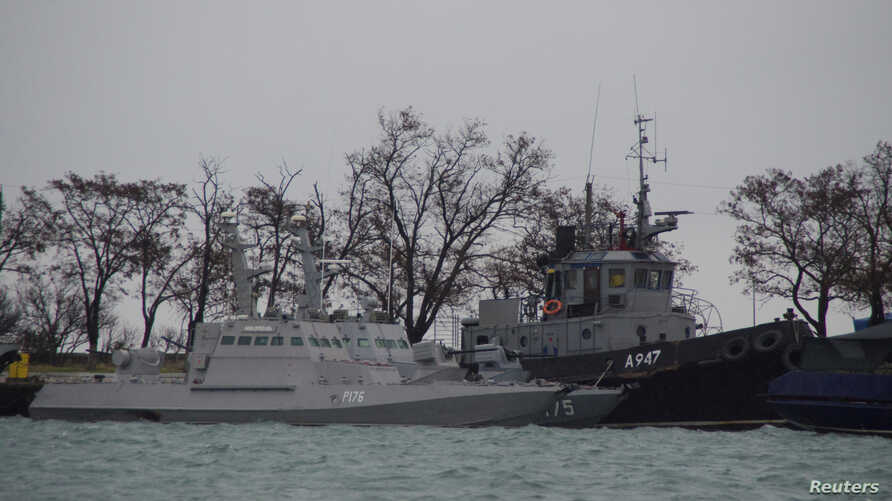 Ukrainian naval ships, which were recently seized by Russia's FSB security service, are seen anchored in a port in Kerch, Crimea Nov. 28, 2018.