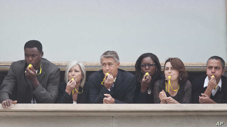 Carl Lewis blowing the whistle on hunger in Rome to launch the UN's 1 Billion Hungry Project.