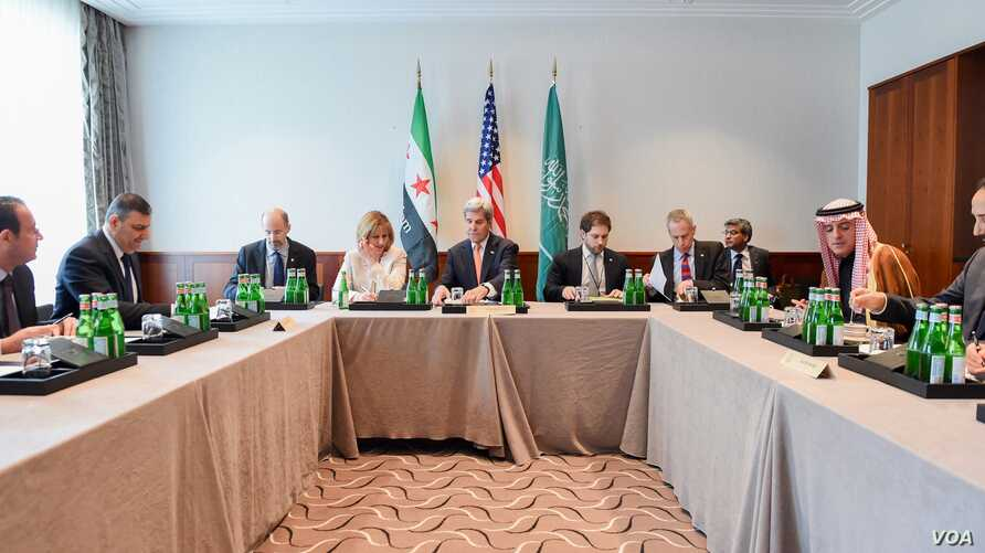 U.S. Secretary of State John Kerry sits with Saudi Arabia Foreign Minister Adel al-Jubeir (right) and Syrian Opposition Leader Dr. Riyad Nijab on Feb. 11, 2016, before a three-way meeting focused on Syria preceding the Munich Security Conference.