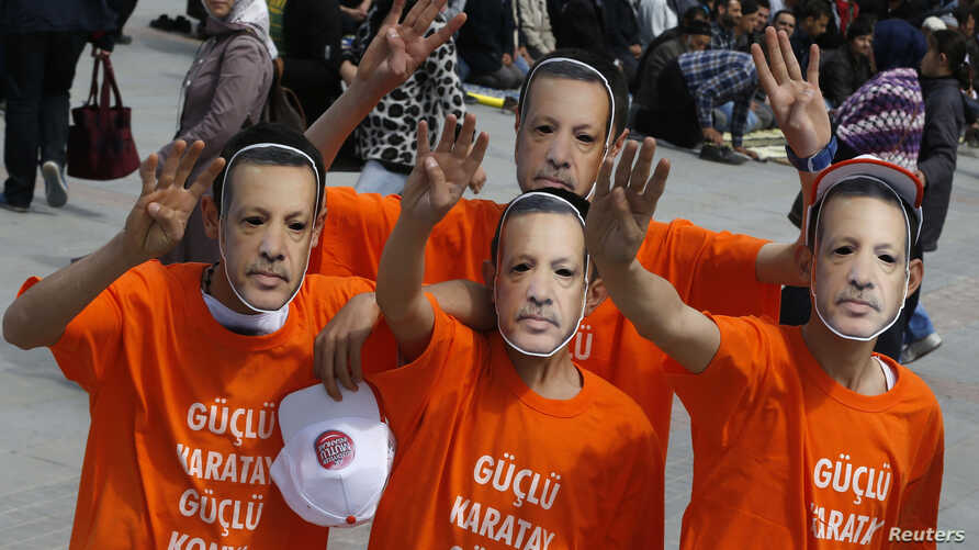 Supporters of the ruling AK Party wear Prime Minister Tayyip Erdogan masks during an election rally in Konya, central Turkey, March 28, 2014.