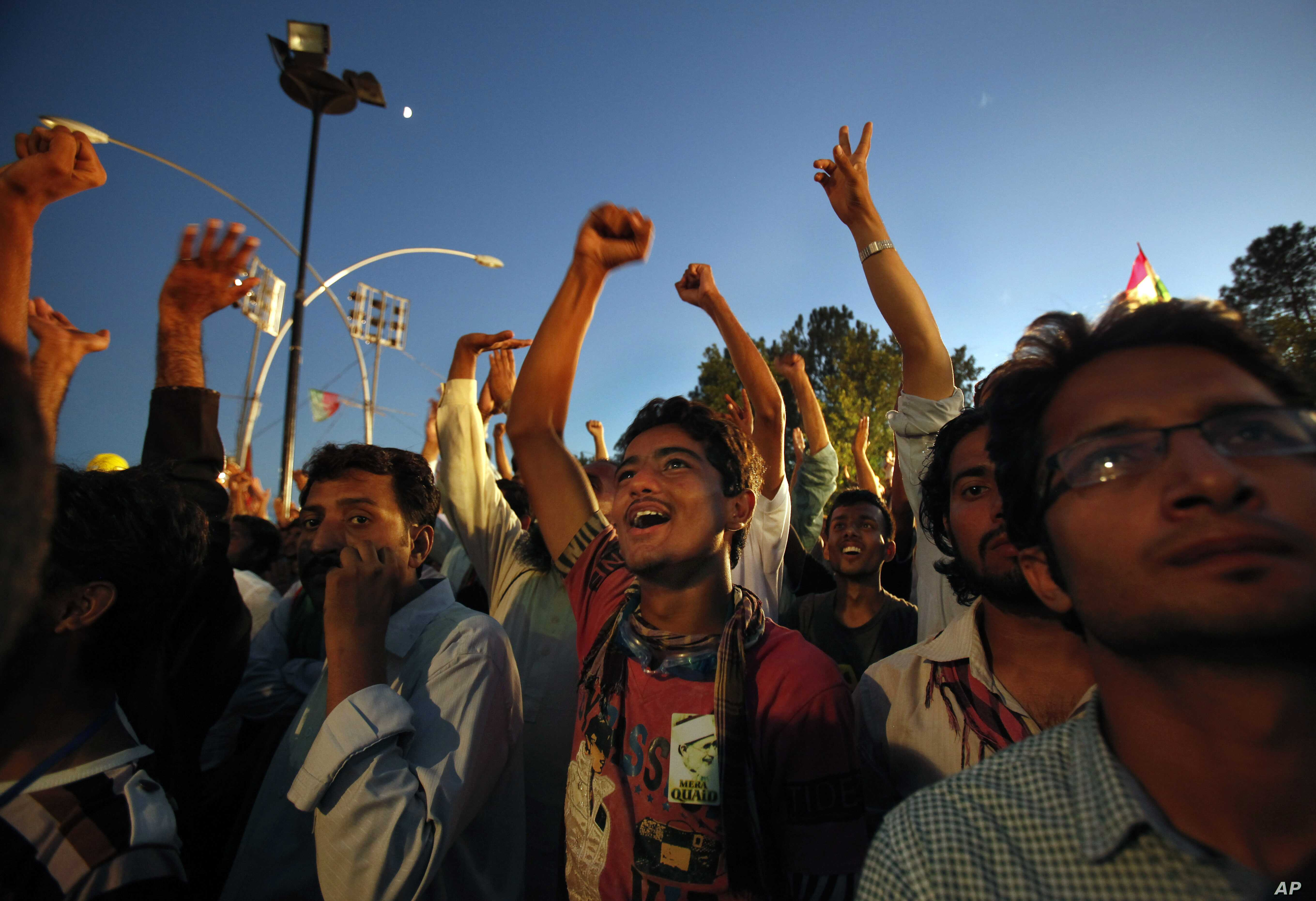Supporters of Pakistan's fiery cleric Tahir-ul-Qadri chant slogans during a protest near Prime Minister's home in Islamabad, Pakistan, Tuesday, Sept. 2, 2014. Anti-government demonstrators led by opposition politician Khan and Tahir-ul-Qadri converge
