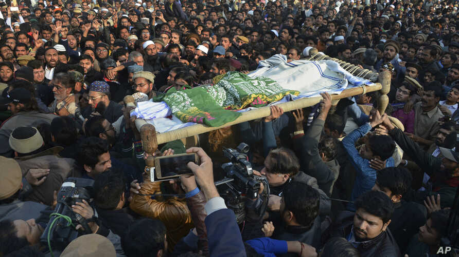 People attend a funeral of a Pakistani girl who was raped and killed, in Kasur, Pakistan, Jan. 10, 2018. Pakistani police said a mob angered over the crime attacked a police station in eastern Punjab province, triggering clashes that left at least tw